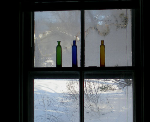 Colored-bottles-in-window